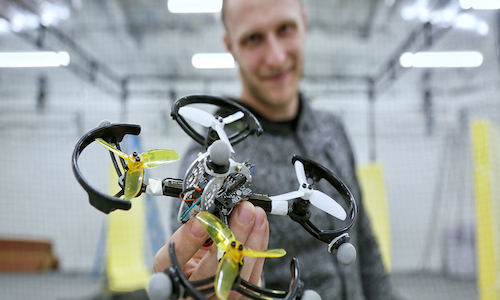 A man holding a robust drone controller.